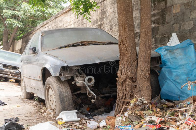 A broke car and a garbage at bengaluru police station.  royalty free stock photography
