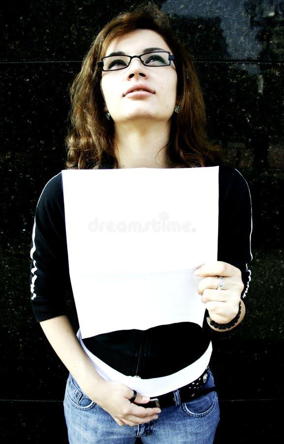 Broke girl student. Broke, sad girl student with bank statement stock images