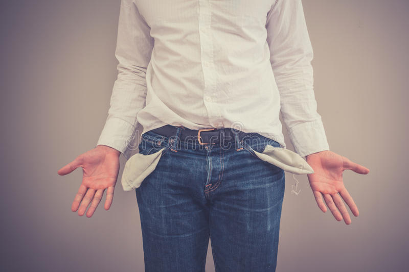 Broke man with empty pockets royalty free stock image