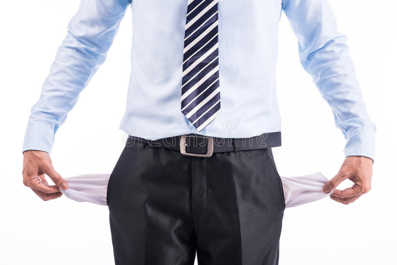 Broke and poor business man with empty pockets stock image