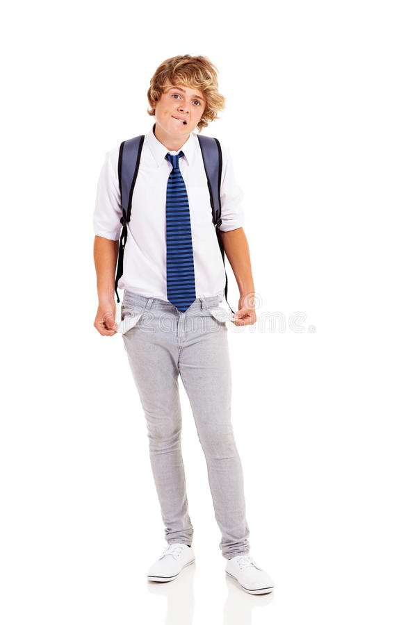 Broke teen boy. With no money and showing empty pockets royalty free stock photography