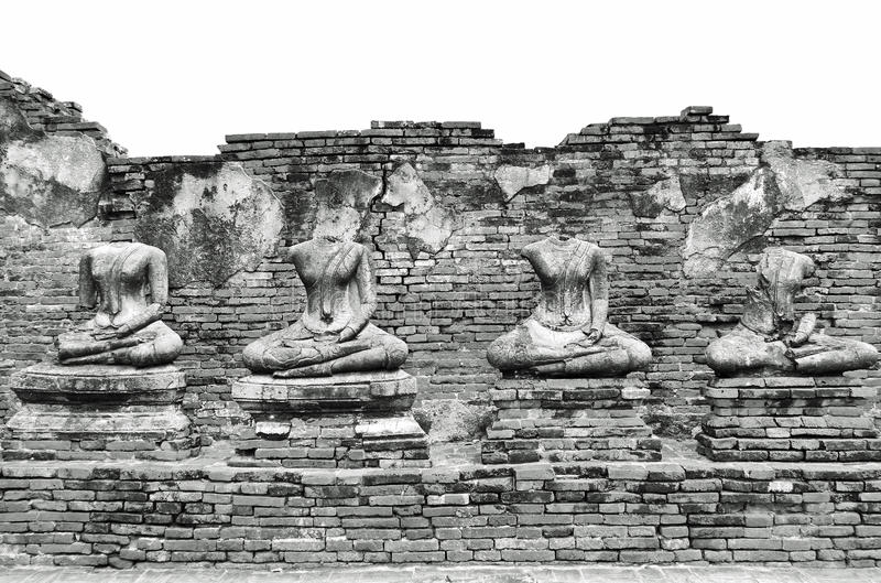 Broken Ancient Buddha Statues Ruins at Wat Chaiwatthanaram in The Historic City of Ayutthaya, Thailand in Classic Vintage Black an royalty free stock photo