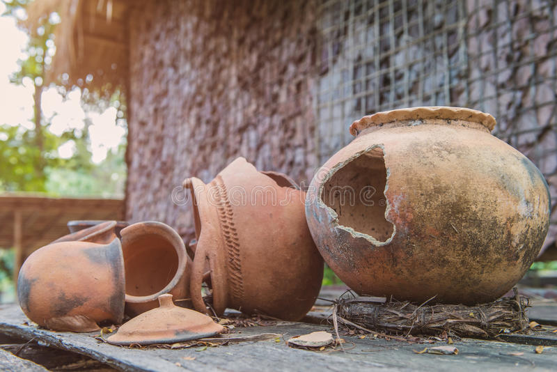Broken antique clay pot or traditional Jar on abandoned hut stock photography