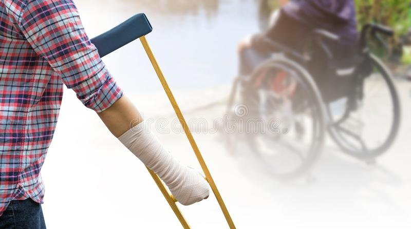 broken arm, injury woman standing wearing shirt and jeans with a royalty free stock image