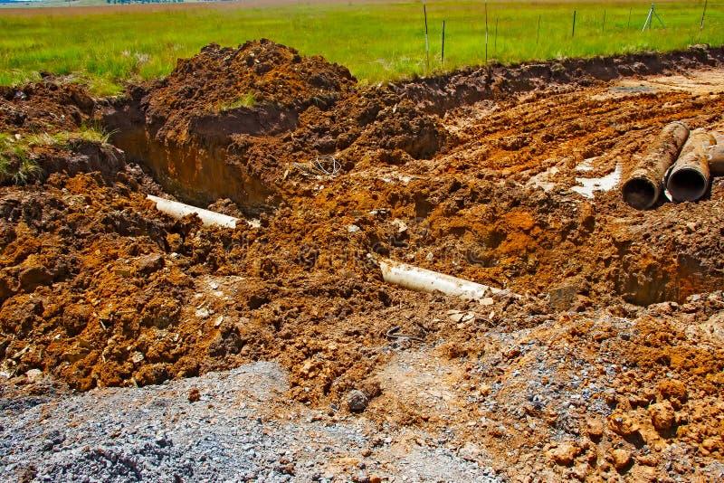 Broken asbestos cement water pipeline excavation royalty free stock images