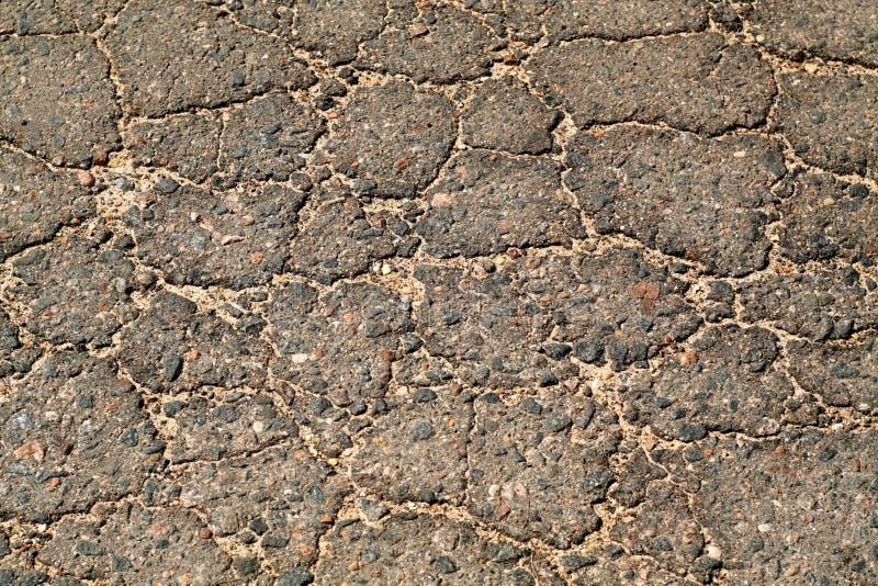 Broken asphalt surface. stock photos