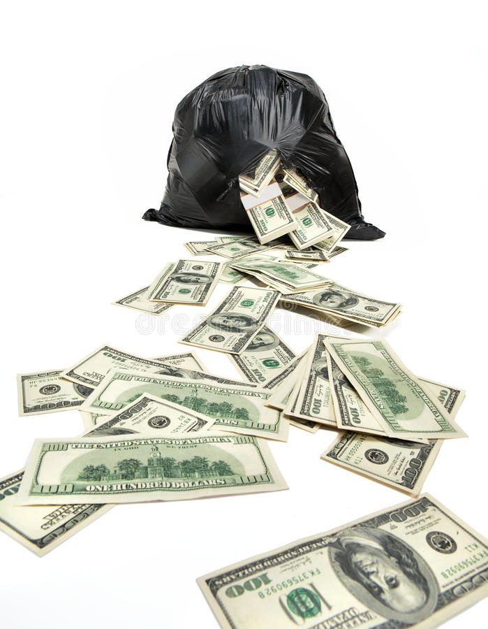 Broken bag of money. Studio photography of black plastic bag with hundred dollar bills on a white background stock photography
