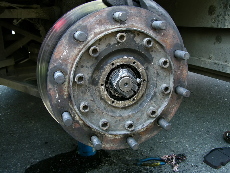 Broken bearing of bus. Broken bearing at a coach bus stock photography