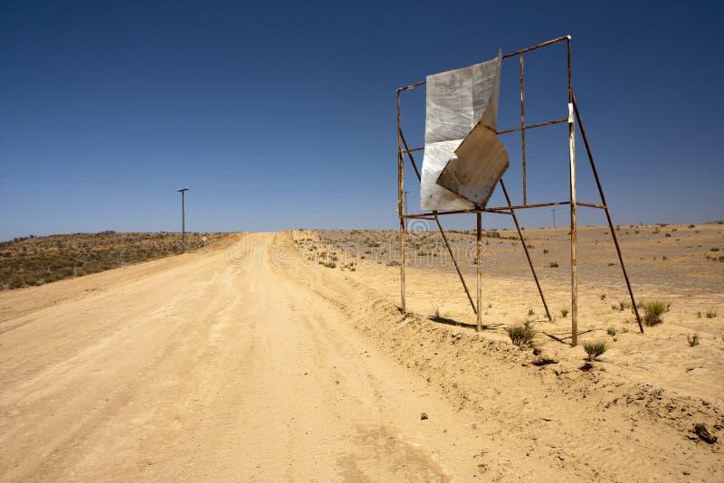 Broken billboard in desert stock photos