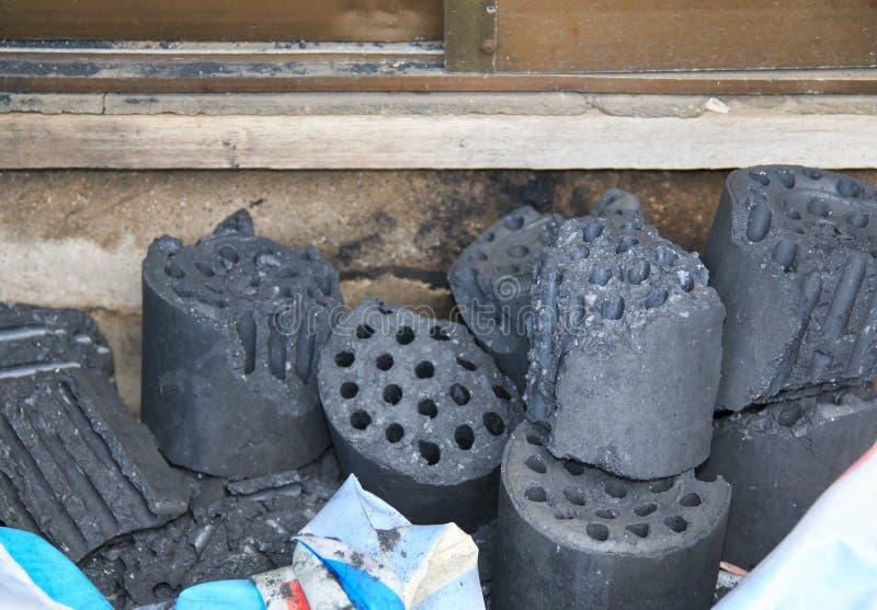 Broken black coal briquette. At the poor house stock photo