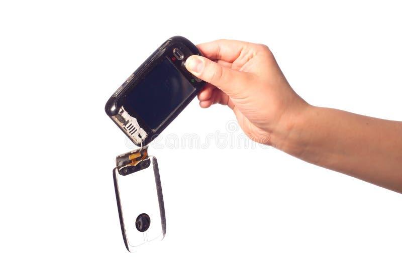 Broken black Smartphone in man's hand. Black Smartphone with Broken flip in man's hand stock photos
