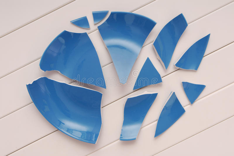 broken blue plate is on table, broken-down dish, crushed tableware is on white background, stock images