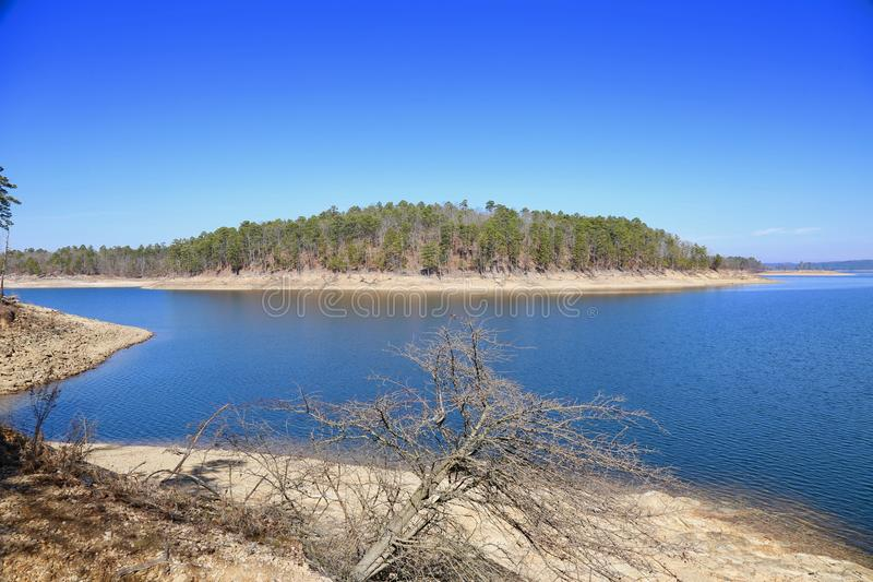 Broken Bow Lake, Oklahoma. Broken Bow Lake is a reservoir in southeastern Oklahoma, located on Mountain Fork River and 9 miles northeast of the town of Broken royalty free stock photo