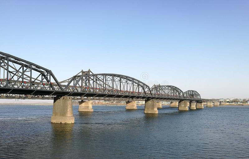 Broken Bridge, Dandong, China opposite to Sinuiju city, North Korea; at Yalu river natural border. It was bombed; repaired only part in China. Taken in April royalty free stock photo
