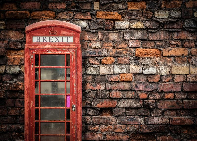 Broken Britain Brexit. Image Representing Broken Brexit Britain Of An Old Peeling Red Telephone Box Against A Grungy Red Brick Wall With Copy Space stock photo