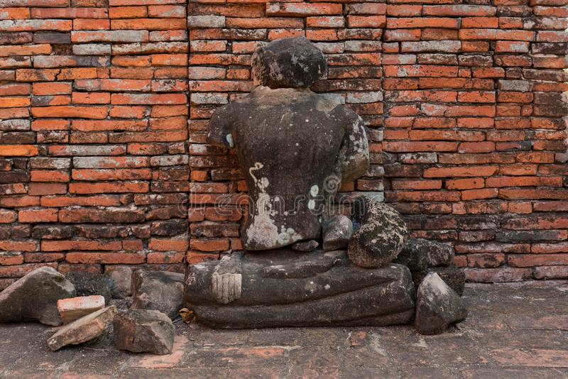 Broken Buddha Ancient temple in Ayutthaya, Thailand. The temple is on the site of the old Royal Palace of ancient capital of. Ayutthaya royalty free stock image