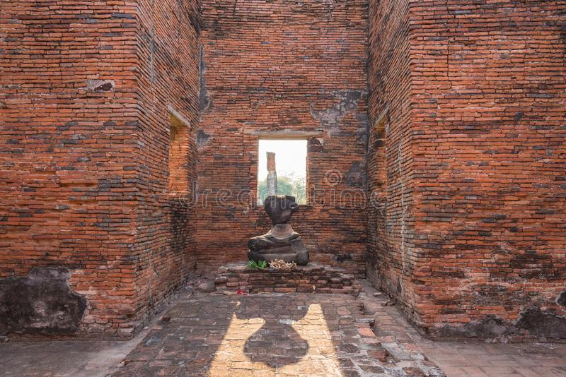 Broken Buddha Ancient temple in Ayutthaya, Thailand. The temple is on the site of the old Royal Palace of ancient capital of. Ayutthaya stock photography