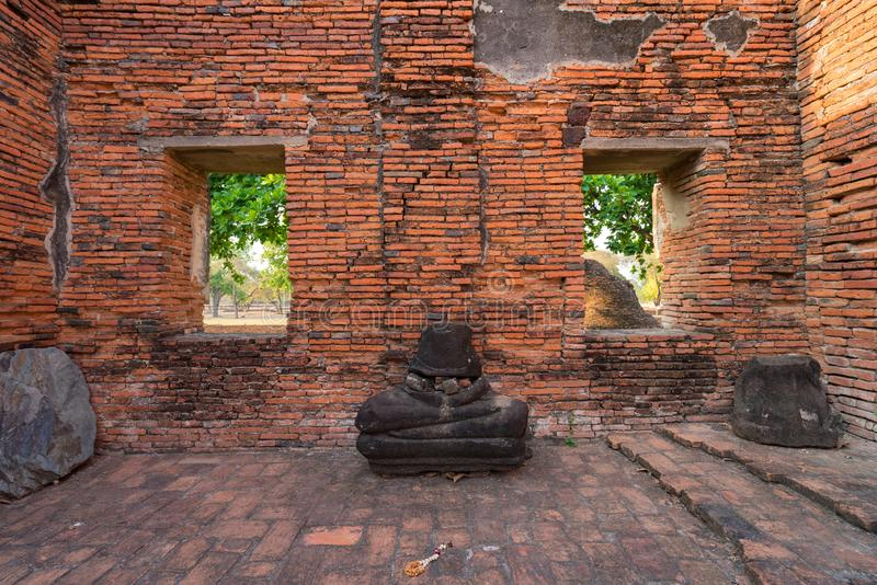 Broken Buddha Ancient temple in Ayutthaya, Thailand. The temple is on the site of the old Royal Palace of ancient capital of. Ayutthaya stock photo