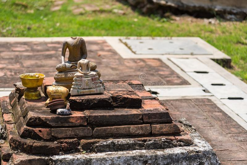 Broken Buddha statue dumped at Wat Mahathat, Ayutthaya, Thailand stock photography