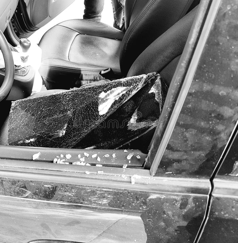 Broken car glass. Automobile insurance coverage, risk and loss, insecurity problem, caused by the crime and delinquency royalty free stock images