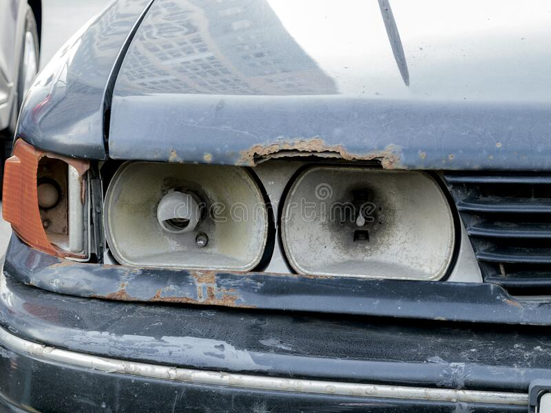 Broken car headlight close-up, broken royalty free stock photos