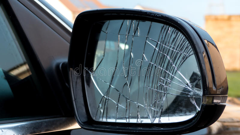 Broken car mirror. Shattered black car mirror royalty free stock images