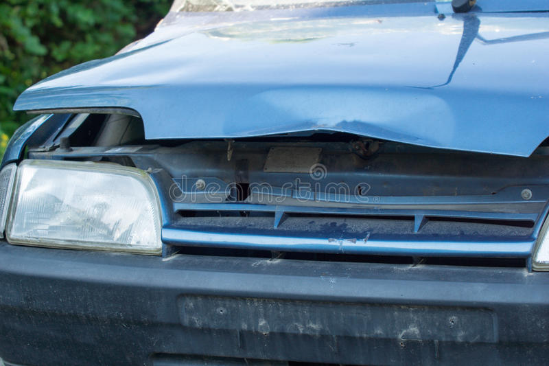 Broken car. Old broken car with a broken bonnet royalty free stock image