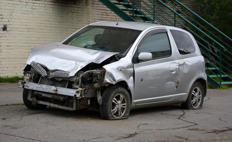 Broken car silver color after the accident stock photos