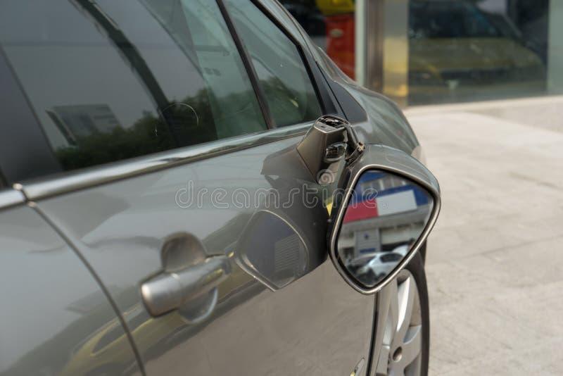 Broken car. Waiting for repairing,broken rear view mirror stock photo