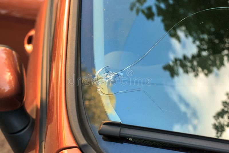 Broken car windshield glass from stone royalty free stock photos