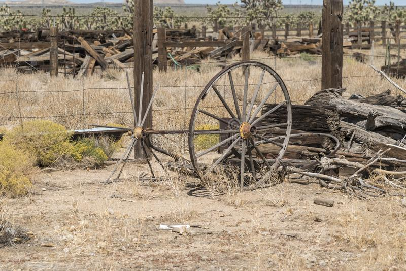 Broken carriage axle at Cima Station Mojave Preserve. Cima is a small unincorporated community in the Mojave Desert of San Bernardino County, California, in stock images