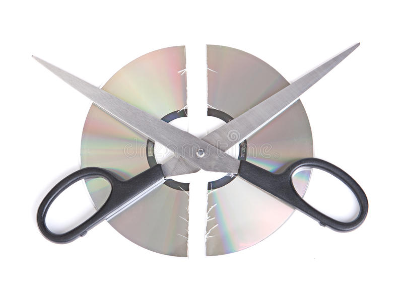 Broken CD disc with scissors isolated on white bac royalty free stock photo