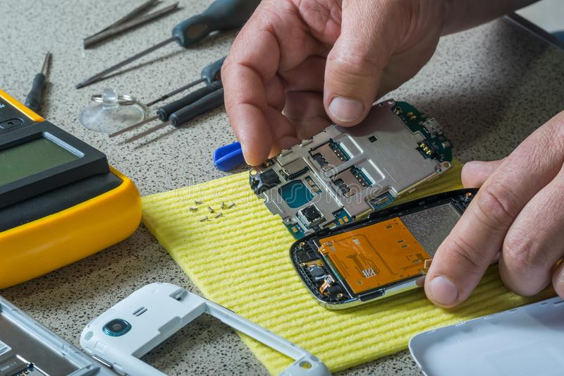 Broken cell phone repair royalty free stock photos