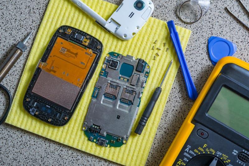 Broken cell phone repair stock images