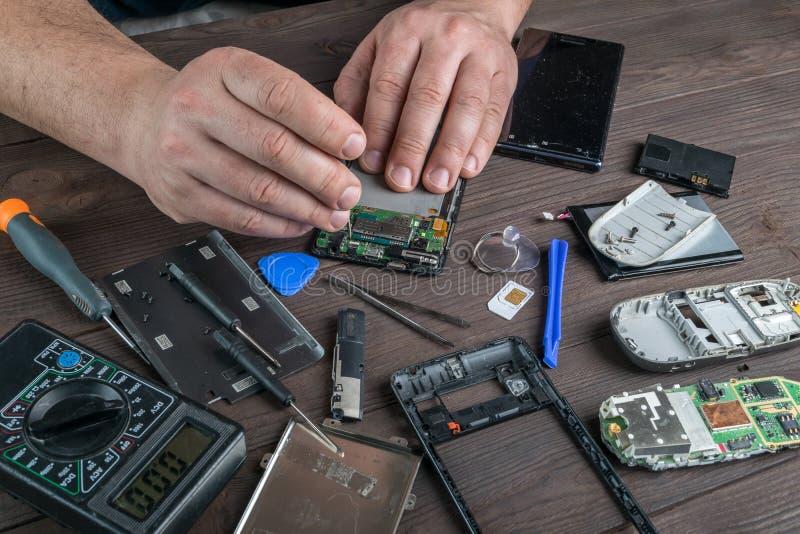 Broken cell phone repair stock image