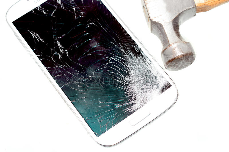 Broken Cell Phone. Cell phone with a broken screen due to a hammer hit stock photos
