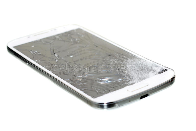 Broken Cell Phone. Cell phone with a broken screen isolated on white royalty free stock image