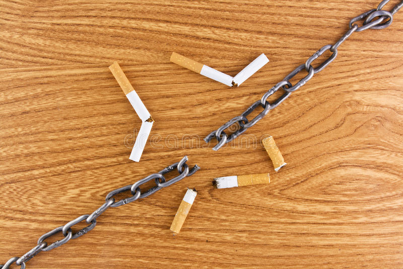 Download Broken Chain Over Wood Texture And Cigarettes Stock Photo - Image: 16641328