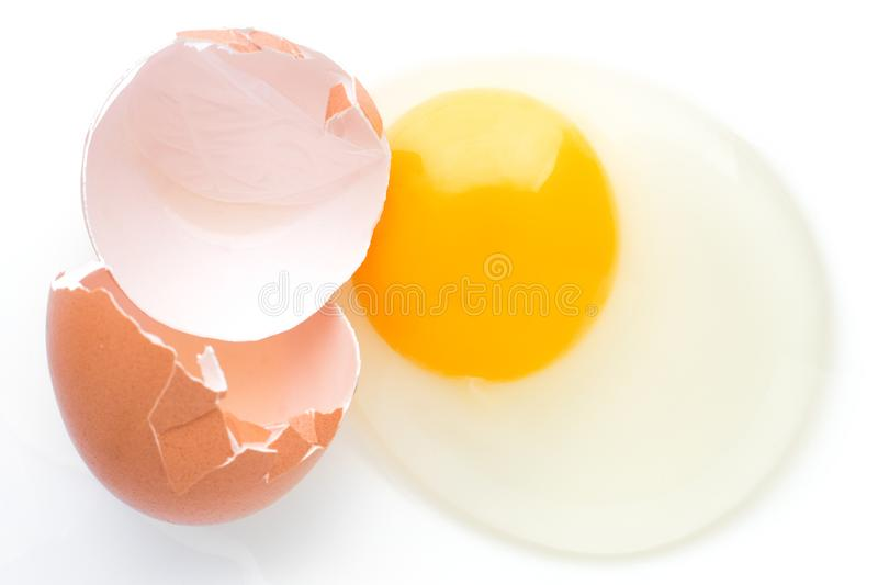 Download A Broken Chicken Egg Lies On A White Background With A Shell, Yo Stock Image - Image of natural, cracked: 105529703