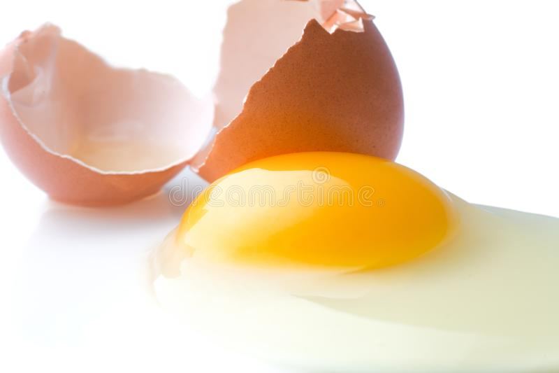 Download A Broken Chicken Egg Lies On A White Background With A Shell, Yo Stock Photo - Image of albumen, chicken: 105529706