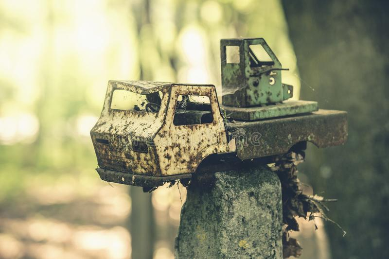 A broken children`s toy car in an abandoned kindergarten in the village of Kopachi royalty free stock images