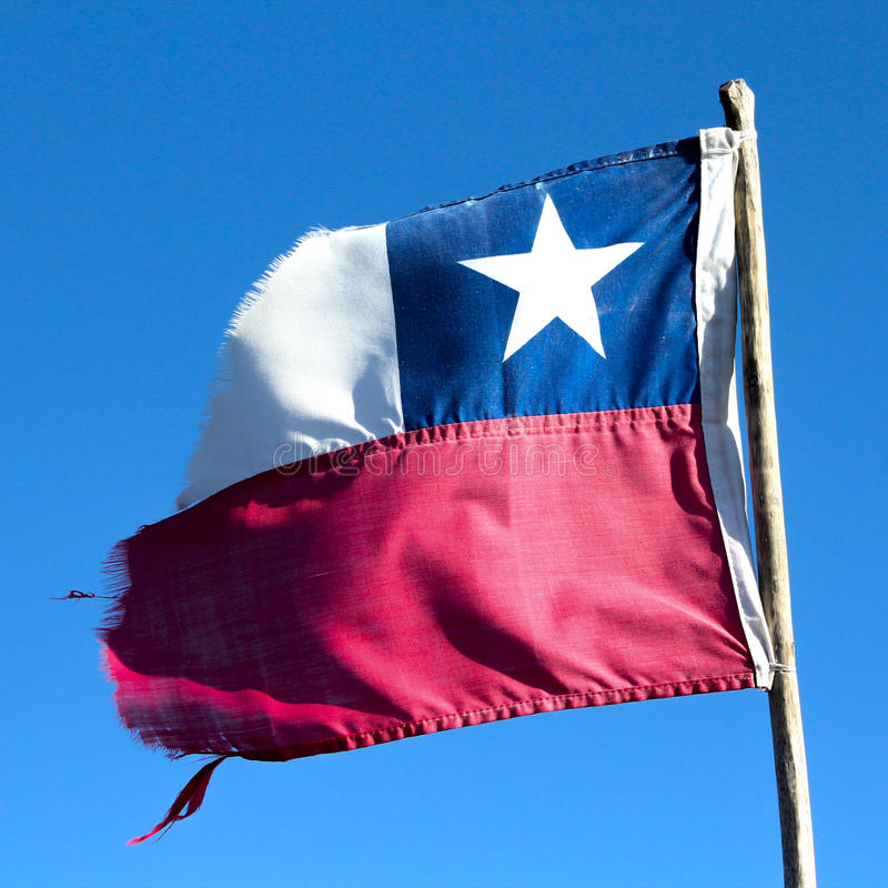 Broken Chilean Flag Flying Over The Blue Sky. Stock Photo