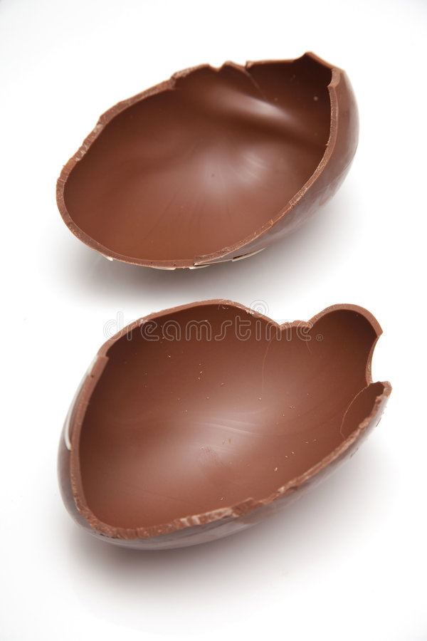 Broken chocolate Easter egg royalty free stock images