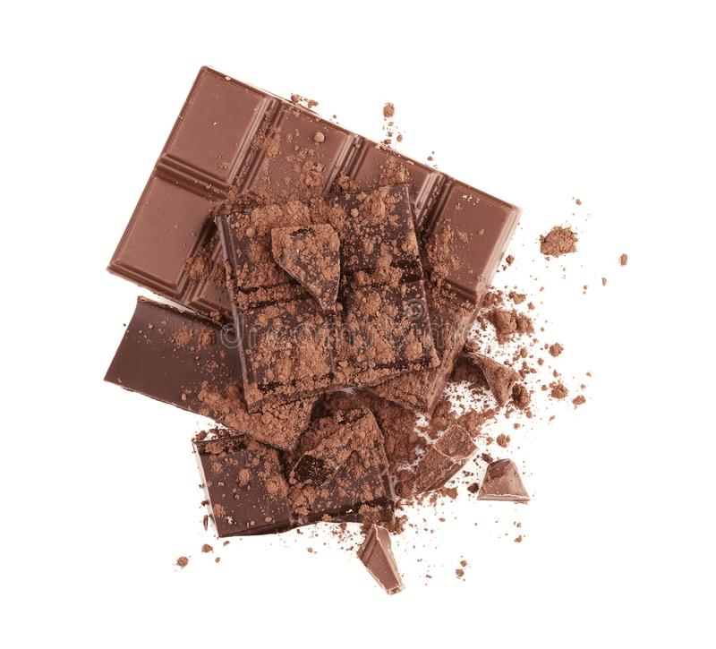 Broken chocolate pieces and cocoa powder royalty free stock photography