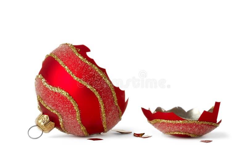 Broken christmas ball. A shattered chrismas ball on a white background