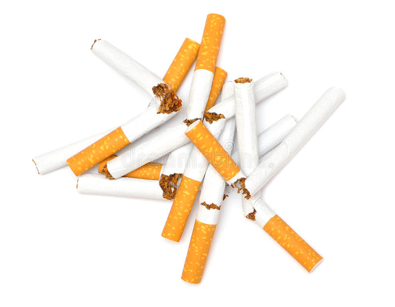 Broken cigarette. First step to quit smoking, broken cigarettes on white stock photo