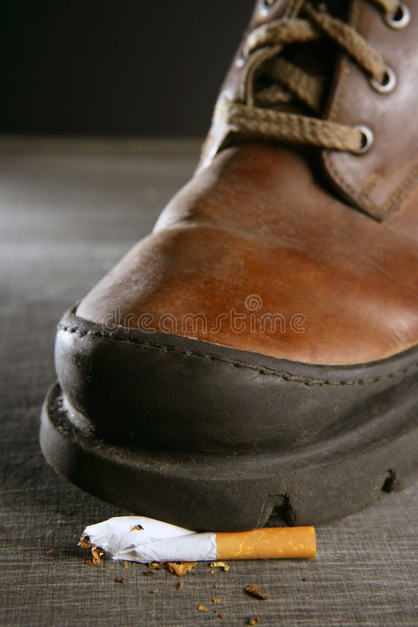 Download Broken Cigarette Tread By A Boot Stock Image - Image: 9097329
