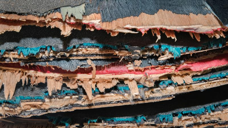 Broken colourful skateboard decks stacked on top of each other,. Skateboard recycling royalty free stock photography