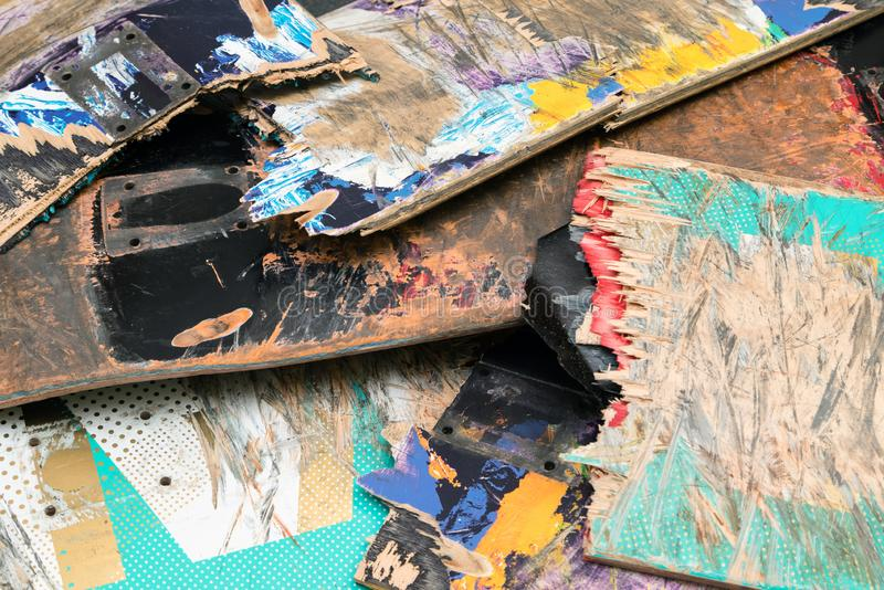Broken colourful skateboard decks stacked on top of each other,. Skateboard recycling royalty free stock images