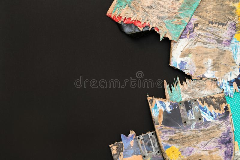 Broken colourful skateboard decks stacked on top of each other,. Skateboard recycling stock image